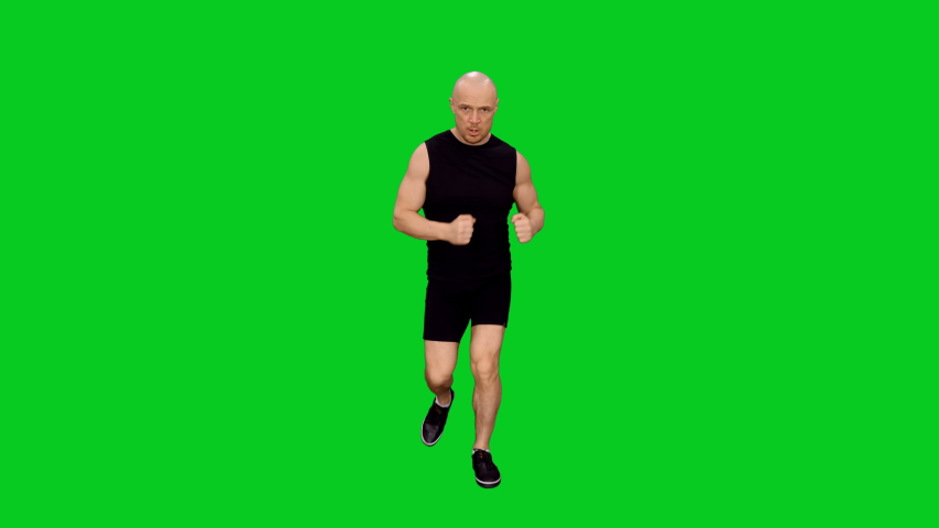 Strong boxer practicing hits while running during training on green screen background, chroma key 4k pre-keyed footage