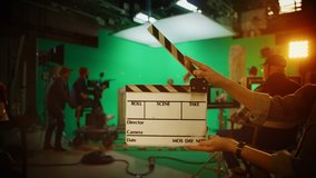 On Film Studio Set Clapperboard Shuts and Director Says