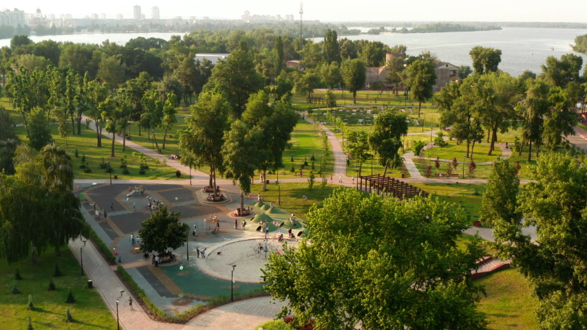 Aerial view. City park with green trees. People are walking in the city park in Kiev, Ukraine