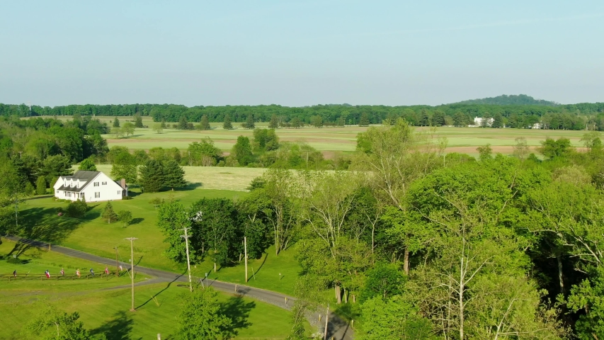 Rising aerial reveals Gettysburg National Military Park battlefield, Little Round Top in distance