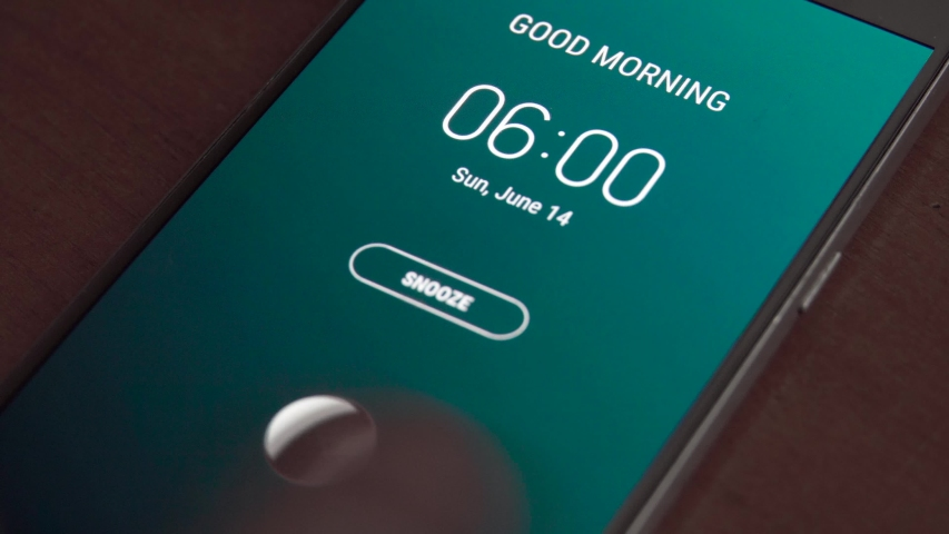 Good morning 6 am alarm clock on the phone, a finger taps snooze. | Shutterstock HD Video #1054758266