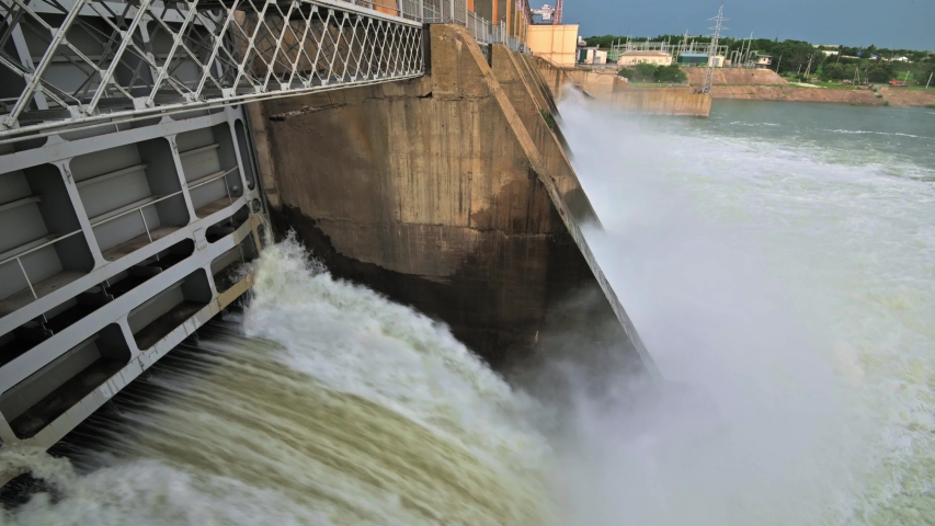 Closeup of massive discharge water from the dam of hydroelectric plant to prevent overflow | Shutterstock HD Video #1054767578