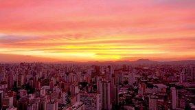 Panoramic view of sunset in city life scene. Great landscape. Sao Paulo, Brazil. Sunset sky. Dramatic sky. Sunset city. Sunrise city. Orange sky. Colored scene. Sunset scene. Cityscape. Skyline. Urban