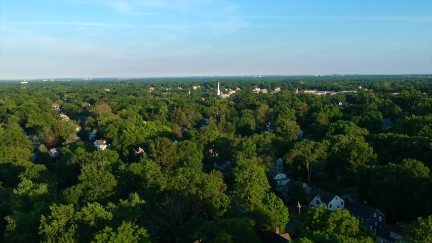 Westfield, NJ 06/22/20: A 4k Drone Shot Of A Drone Heading Towards The Presbyterian Church Of Westfield, NJ New Jersey At Tree Level Birds Eye View Over A Suburban Neighborhood In The Summer At Sunset
