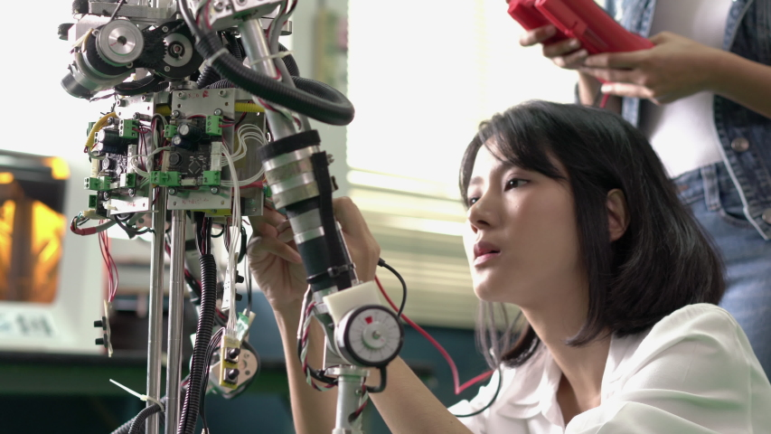 Asian engineer collaborating development robot in modern laboratory. Developers experiment control microchip and build electronics. concept of technology, robotic engineering, and industrial robot. Royalty-Free Stock Footage #1054776563