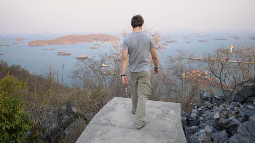 Man Walking Down Long Stairway From Island Hill Top | Shutterstock HD Video #1054777736