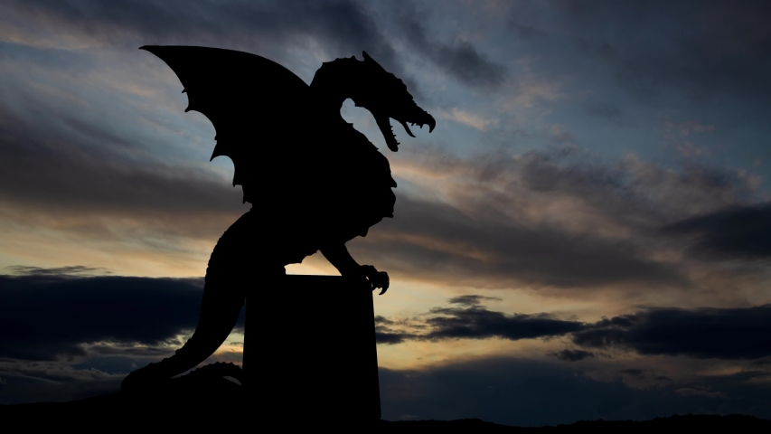 Dragon At Zmajski Most, Time Lapse at Sunrise with Fast Clouds and Dark Silhouette of Ljubljana Icon, Slovenia Royalty-Free Stock Footage #1054787003