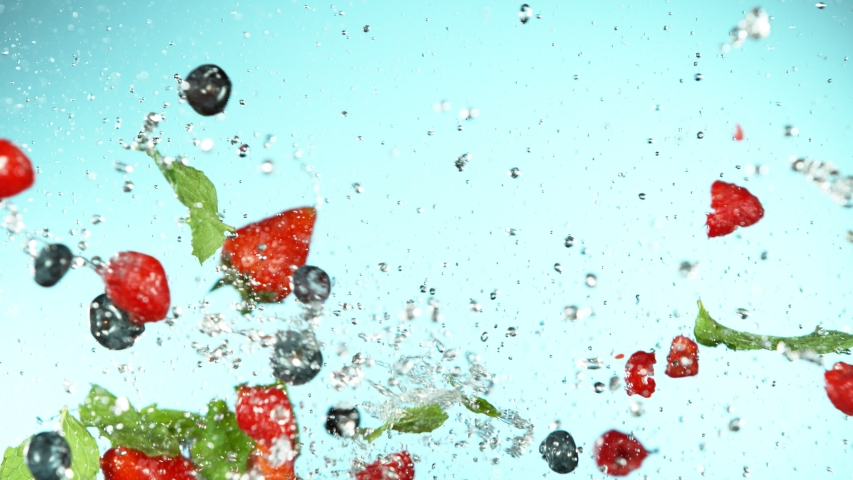 Super slow motion of berries fruit flying up in the air with water splashes. Filmed on high speed cinema camera, 1000 fps. Royalty-Free Stock Footage #1054789286
