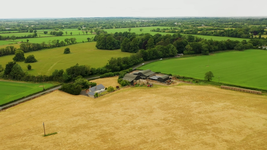 Aerial view moving forward over farmland, County Kilkenny, Ireland. Drone panning right   Shutterstock HD Video #1054789382