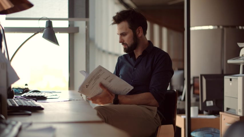 Focused Lawyer Manager With Corporate Financial Audit Report Document.Freelancer Work With Stock Market Data.Creative Employee Analyzing Paperwork.Lawyer Businessman Working In Office On Workplace | Shutterstock HD Video #1054805231