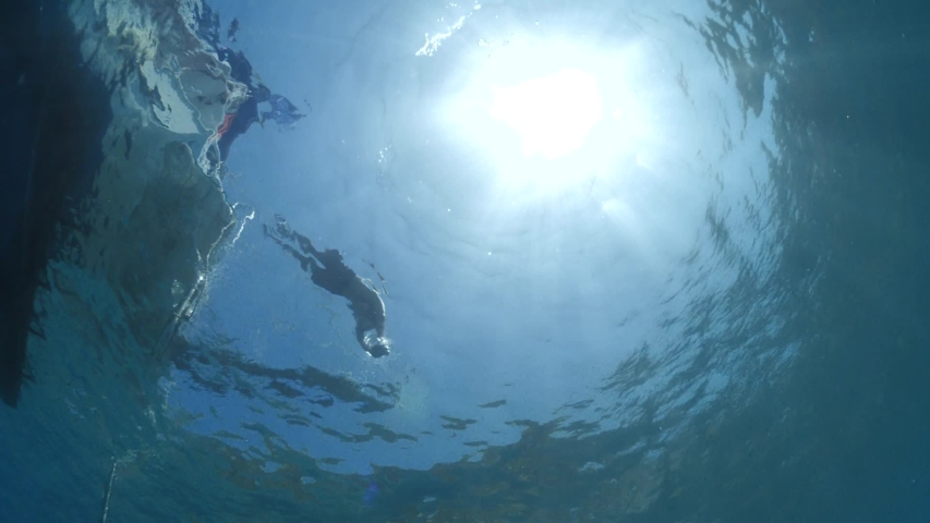 diver jumping in the water from boat underwater diving scenery slow motion ocean scenery sun beams and rays Royalty-Free Stock Footage #1054816568