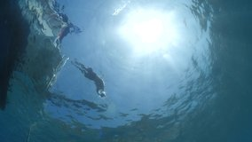 diver jumping in the water from boat underwater diving scenery slow motion ocean scenery sun beams and rays