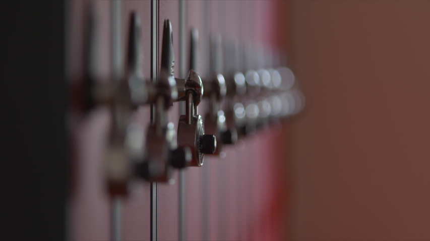 Security combination padlock school college student lockers focus pull Royalty-Free Stock Footage #1054817807
