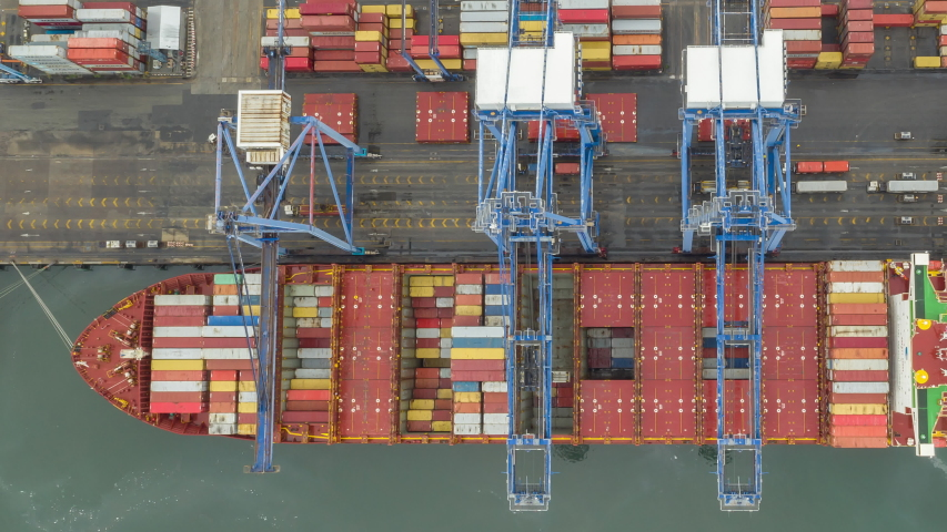 Time lapse Container ship in export and import business and logistics. Shipping cargo to harbor by crane. Water transport International. Aerial view and top view. | Shutterstock HD Video #1054819826