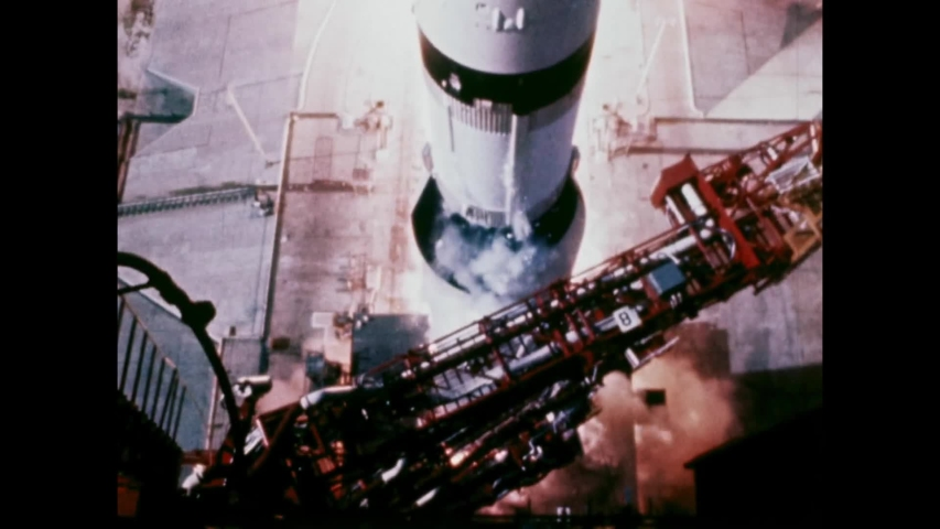 1969 - NASA's Apollo 11 is launched from Cape Kennedy, and men in Mission Control watch its ascent through binoculars.