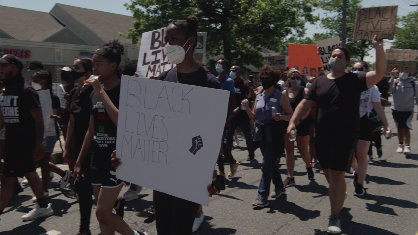 Long Island, NY / USA - June 2020: Protestors march for the Black Lives Matter movement in Long Island