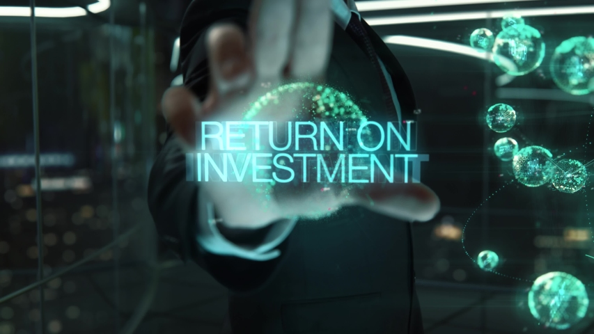Businessman with Return on Investment hologram concept Royalty-Free Stock Footage #1054825502