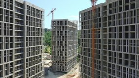 Construction of a multi-storey apartment building. Aerial video. Quadcopter. Drone. Multi-quarter house