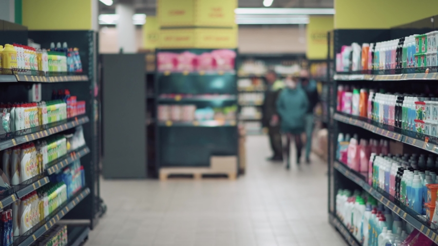 Girl meets her friend in the store. girls greet their elbows during a pandemic. Royalty-Free Stock Footage #1054875629