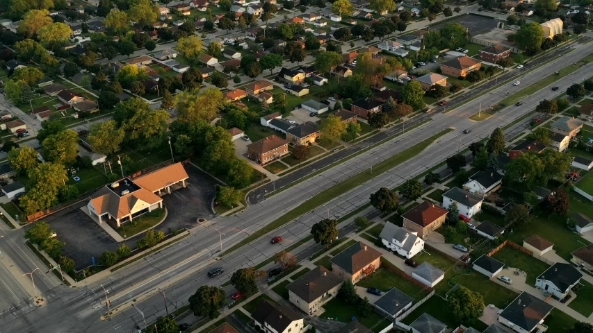 Aerial view of american suburb at summertime.  Establishing shot of american neighborhood. Real estate, top down view of residential houses. Drone shot, from above