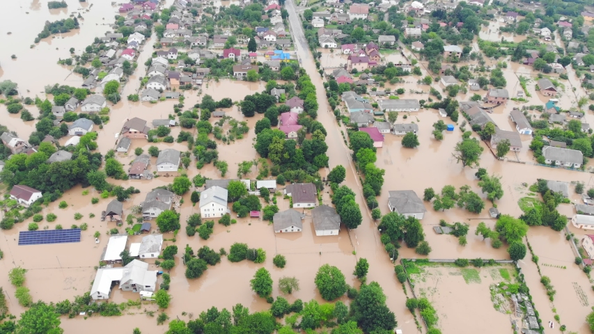 Aerial view City is flooded by a big river. A river that overflowed during the rains and flooded a large city.