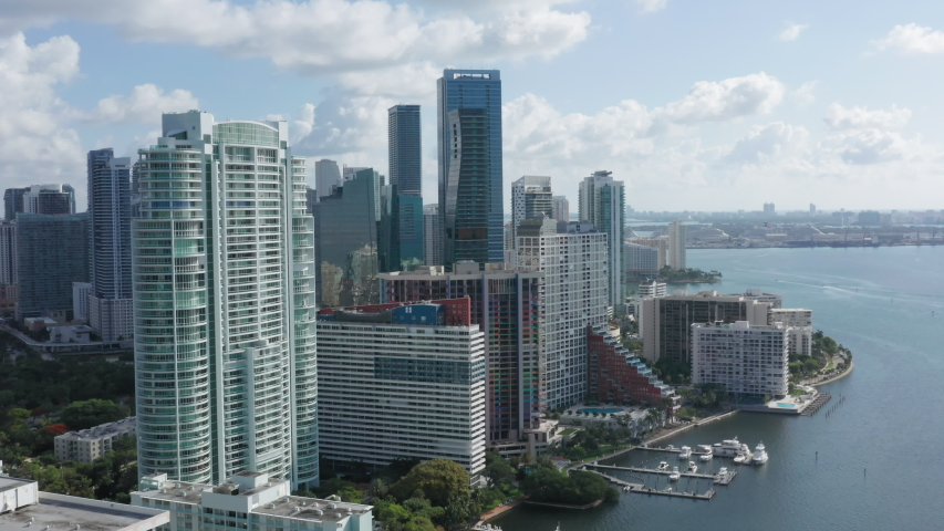 4K aerial overview of Miami Downtown. Beautiful business and residential buildings are at the frontline. Expensive apartments in the skyscrapers with the Atlantic Ocean view in Florida, USA