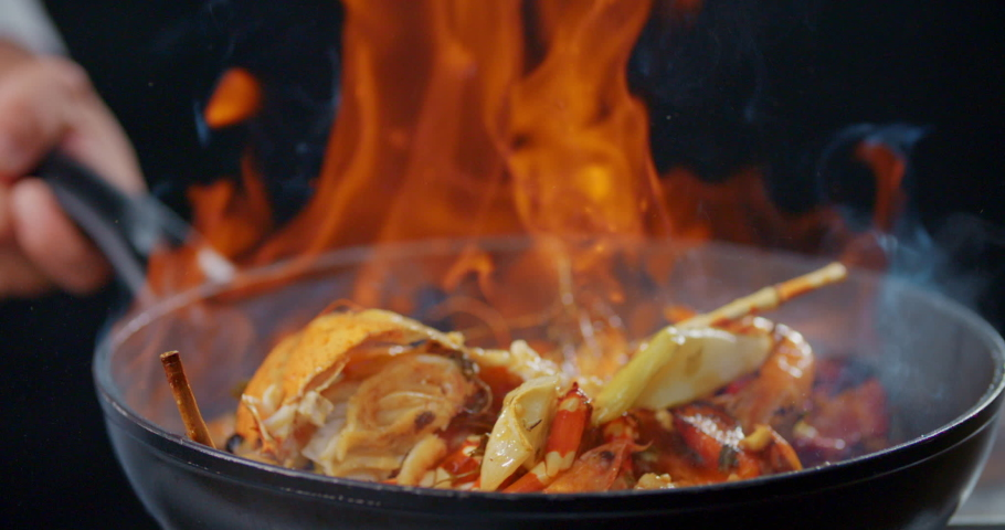 Side View Slow Motion Flambe Shrimp and Crab Shell Royalty-Free Stock Footage #1054890938