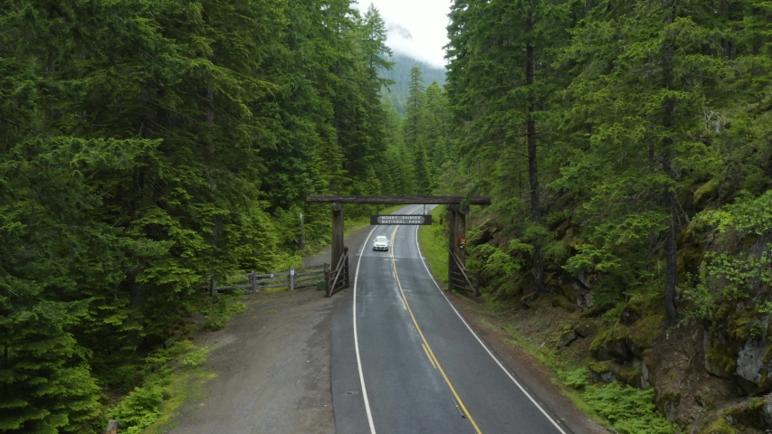 Car Exits Mount Rainier National Park to Go Home at End of Vacation, Drone Flies Over Sign | Shutterstock HD Video #1054894835