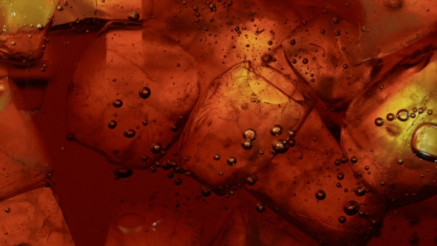 Ice Cubes with Cola, Macro Shot. Super Slow Motion Filmed on High Speed Camera.   Shutterstock HD Video #1054896011