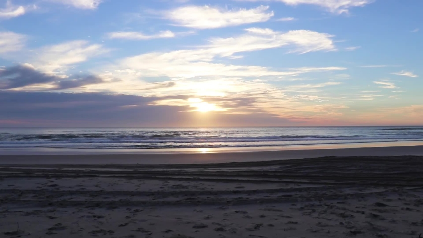 Drone Time Lapse Above A Coastal Beach With White Sandy Shore At Sunrise | Shutterstock HD Video #1054896422