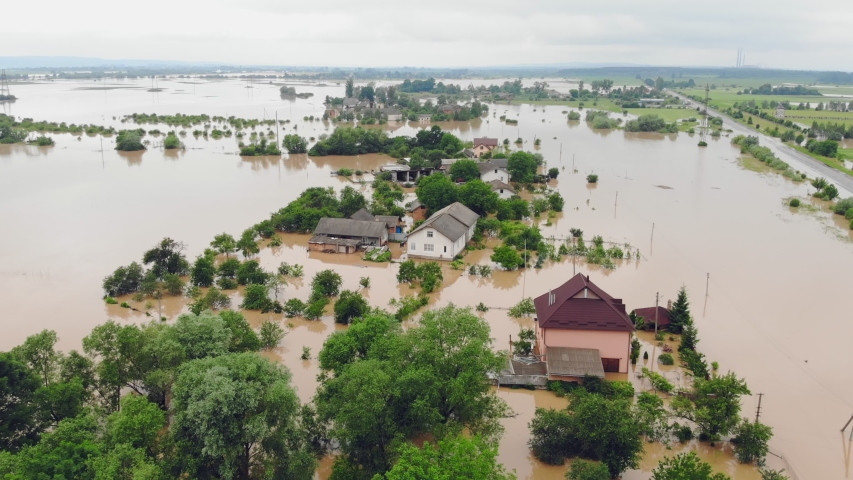 Aerial view Floods and flooded houses. Mass natural disasters and destruction. A big city is flooded after floods and rains. Royalty-Free Stock Footage #1054900889