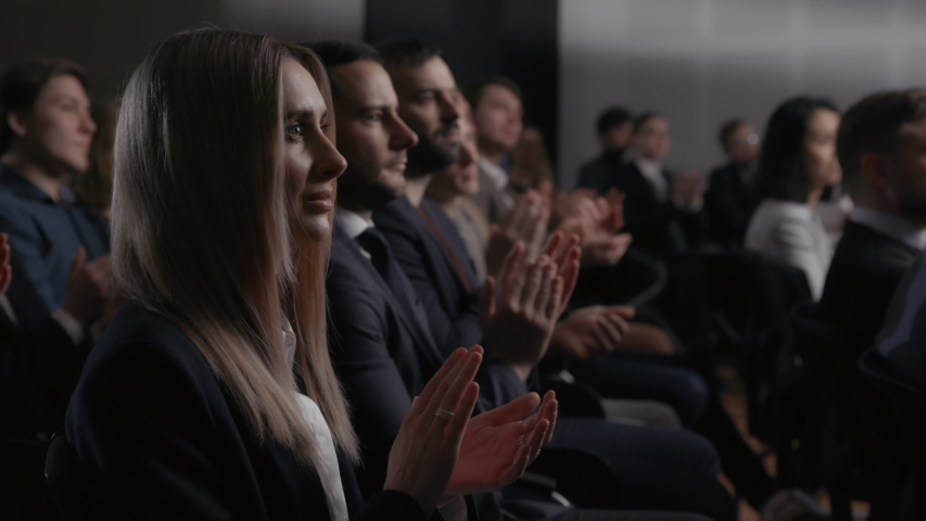 Group of people at congratulation speech of business conference or economy forum. Stage talk at summit meeting in crowded hall. Applause of attractive woman clapping hands at modern event slow motion Royalty-Free Stock Footage #1054902005