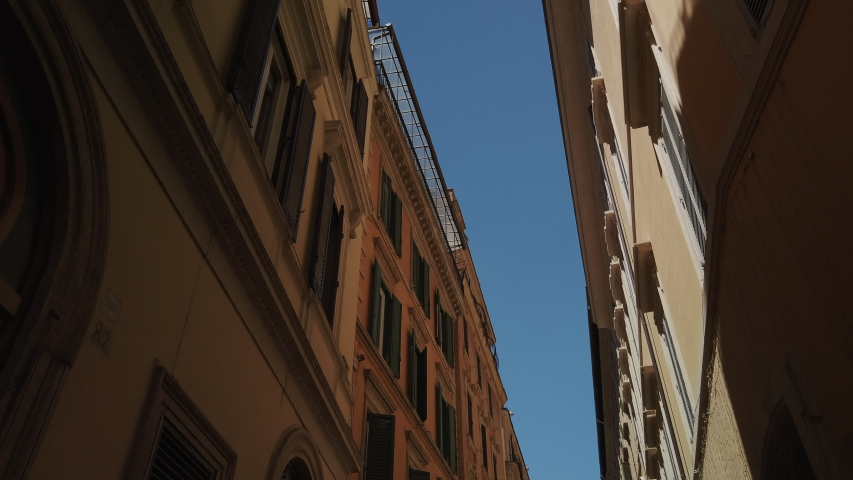 4K. Streets of Rome symbol of Dolce vita. historic buildings in pastel colors. sunny summer day. narrow alleys and squares. | Shutterstock HD Video #1054902302