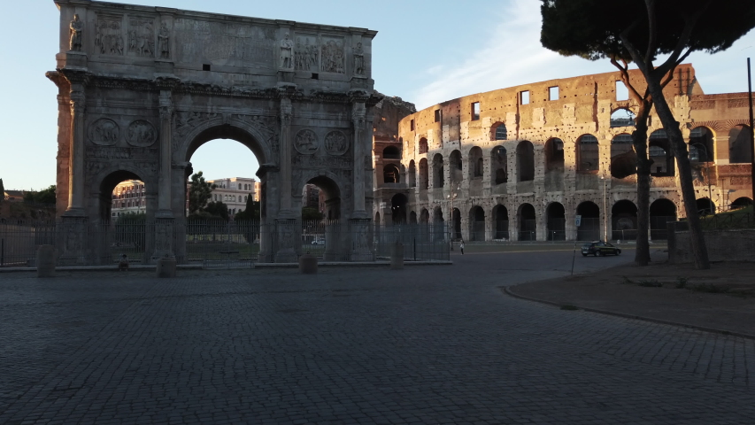 Sunset on the deserted colosseum square, without tourists due to the lockdown due to the pandemic of the corona virus. Roma Italy during covid emergency | Shutterstock HD Video #1054902365