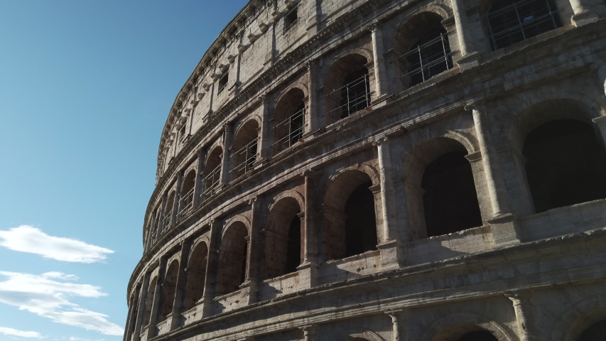 Facade of the Colosseum illuminated by the morning sun. Slide on the arches of the Colosseum symbol of Rome. | Shutterstock HD Video #1054902368