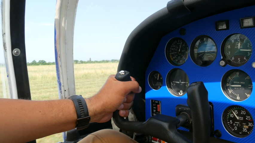 The hands of a professional pilot hold the helm and control panel of an airplane and pilot a small plane. Acceleration for takeoff