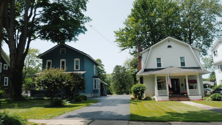 Ride along a typical American suburb, view from a car window. Usa Road Trip | Shutterstock HD Video #1054920380
