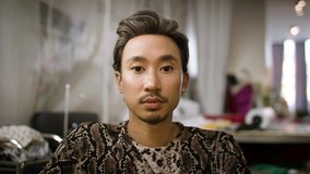 Stylish fashion designer portrait. Handsome and authentic creative portrait. Asian man shot in slow-motion and in 4k.