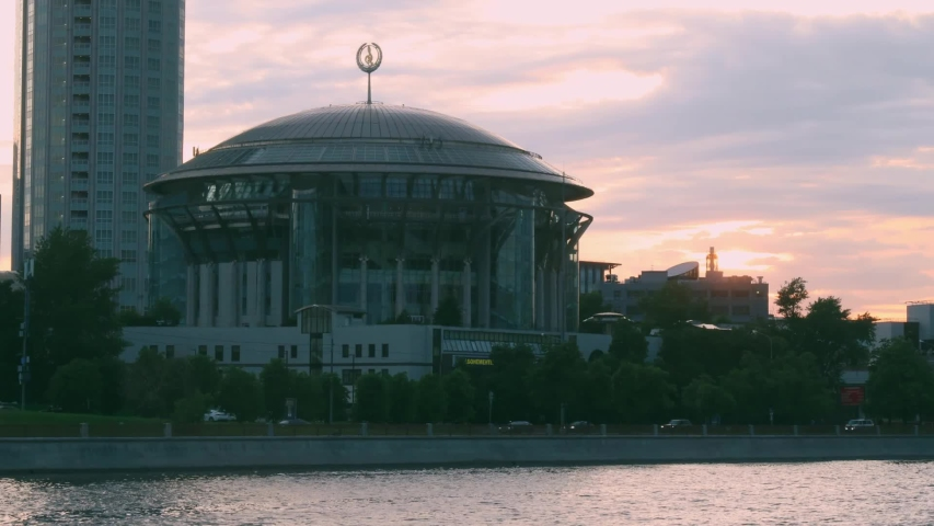 MOSCOW - June, 2020: House of Music and river embankment at sunset time. Timelapse.