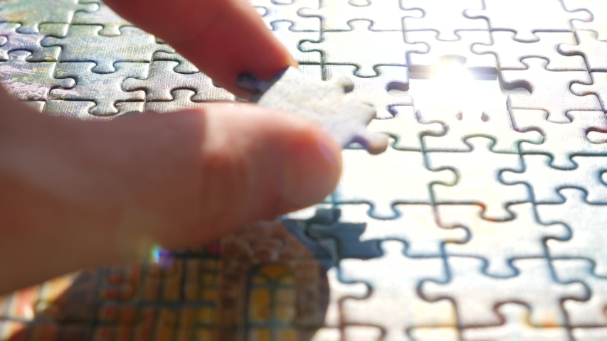 Finding the solution concept. Hand matching jigsaw halves. Leisure activity. Achieving the goal step by step. Engaging in successful work finding business solution, corporate unity Royalty-Free Stock Footage #1054925186
