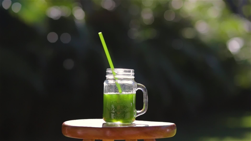 Portrait of female drinking green juice detox cocktail. woman drinking fruit smoothie . Fitness and healthy lifestyle concept. | Shutterstock HD Video #1054926173