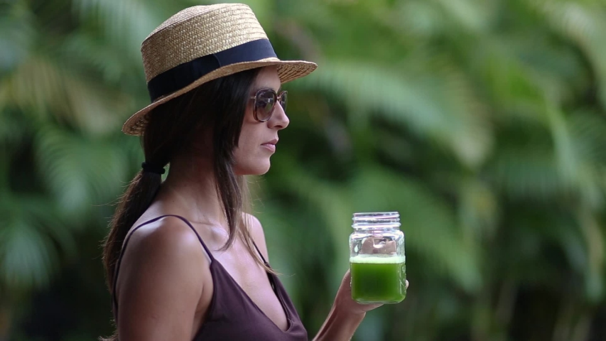 Portrait of female drinking green juice detox cocktail. woman drinking fruit smoothie . Fitness and healthy lifestyle concept. | Shutterstock HD Video #1054926176