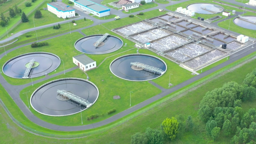 Aerial view to sewage treatment plant. Grey water recycling. Waste management theme. Ecology and environment in European Union.