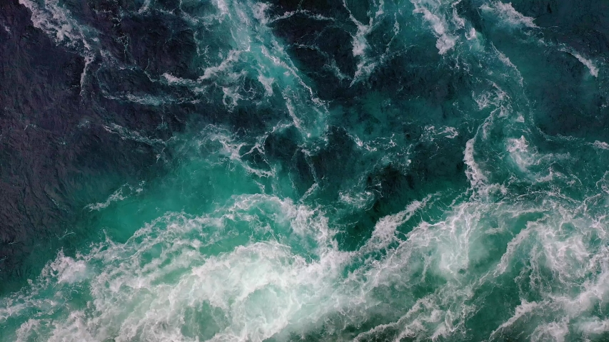 Waves of water of the river and the sea meet each other during high tide and low tide. Whirlpools of the maelstrom of Saltstraumen, Nordland, Norway Royalty-Free Stock Footage #1054951196