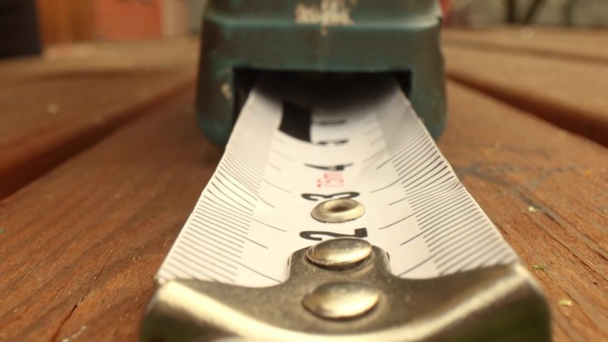 Roll of measuring tape in motion macro | Shutterstock HD Video #1054951217