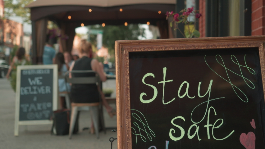 Stay Safe sign on sidewalk with outdoor dining in bkrd Brooklyn Covid reopening Royalty-Free Stock Footage #1054979249