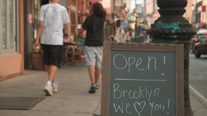 Alt Open Brooklyn We Love You sign on sidewalk Brooklyn Covid reopening | Shutterstock HD Video #1054979267