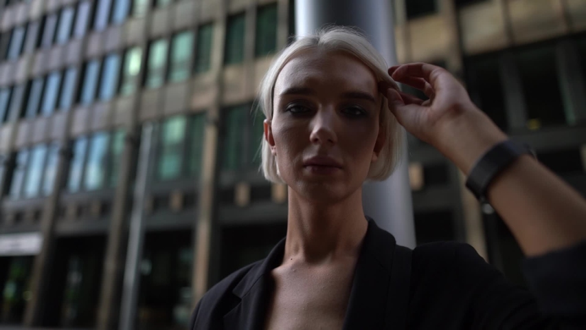 Trans woman is in big city, portrait shot, blonde effeminate guy with makeup | Shutterstock HD Video #1054998347