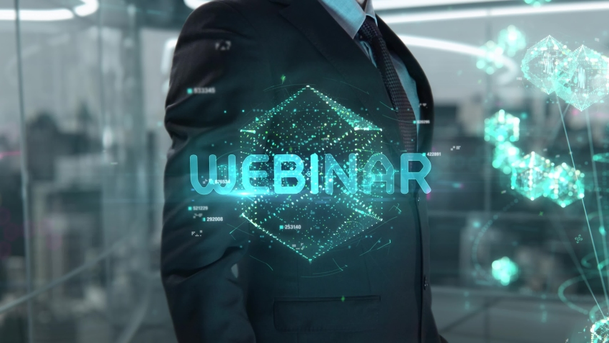 Businessman with Webinar hologram concept Royalty-Free Stock Footage #1055004827