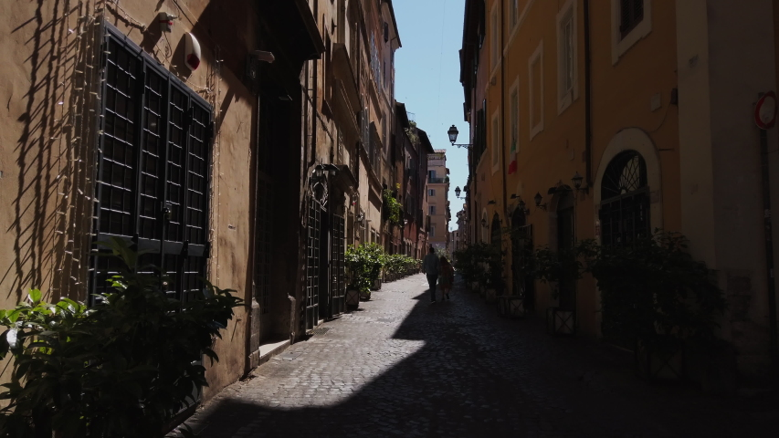 4K. Streets of Rome symbol of Dolce vita. historic buildings in pastel colors. sunny summer day. narrow alleys and squares. Trastevere's streets | Shutterstock HD Video #1055010227